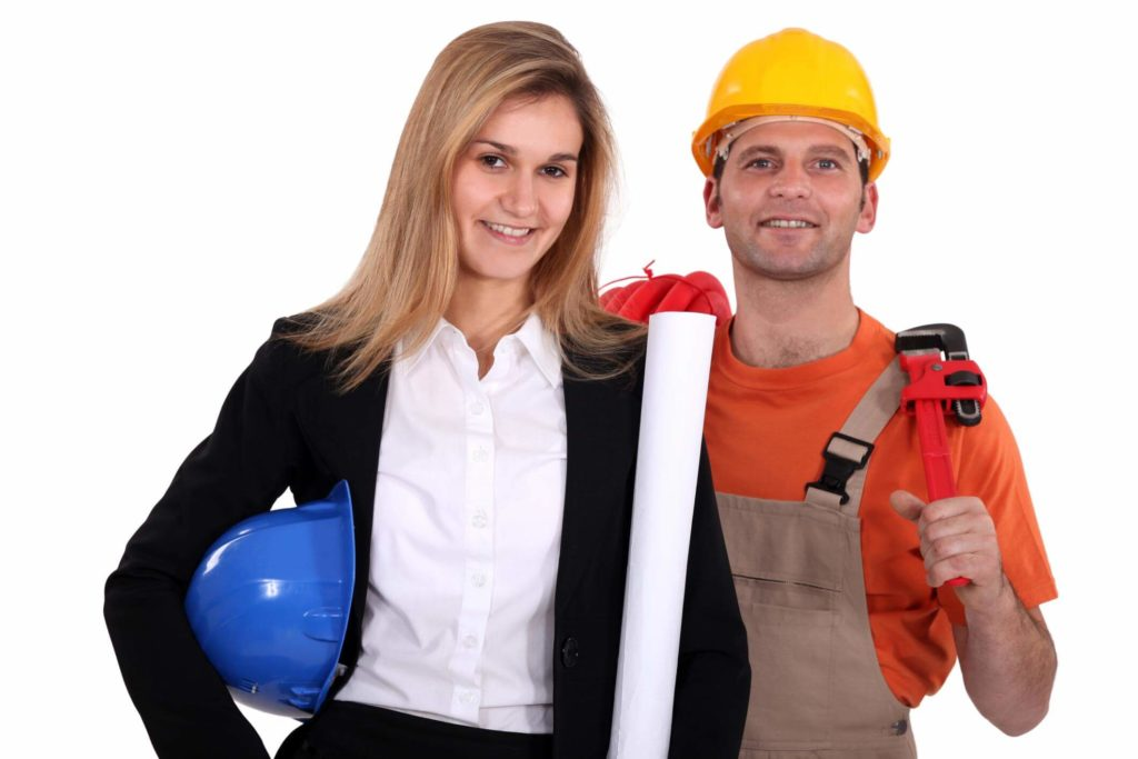 Female engineer and male worker standing side by side