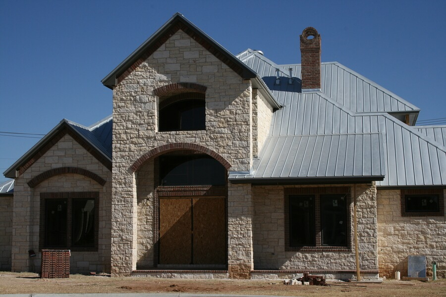 Newly custom built home with metal roof and rock construction