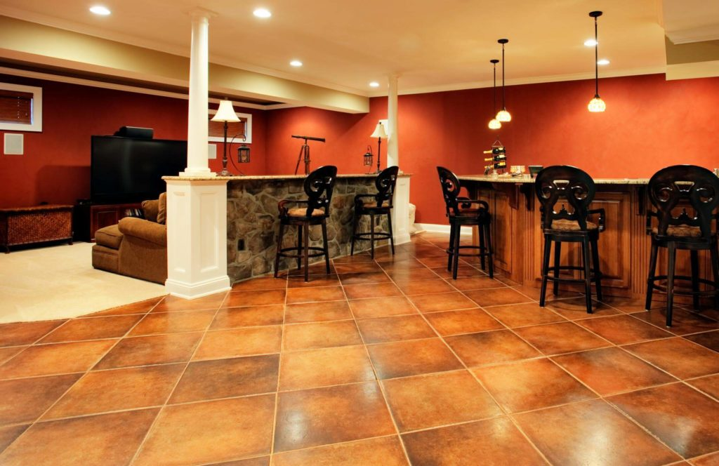 Newly renovated basement with brown interior and tiles