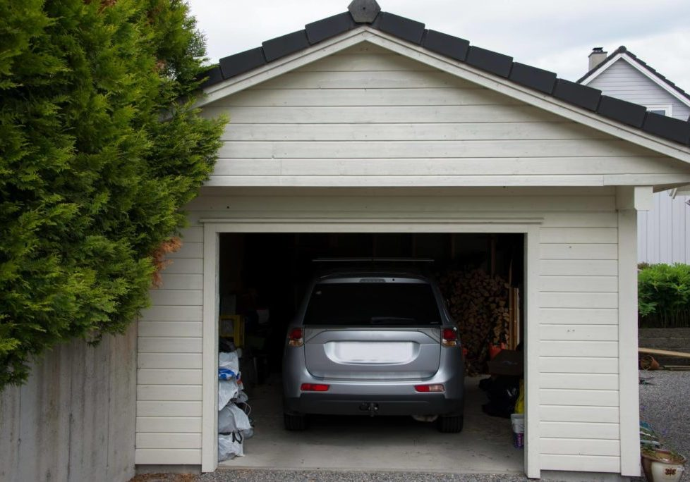 Newly built garage with a grey car in it